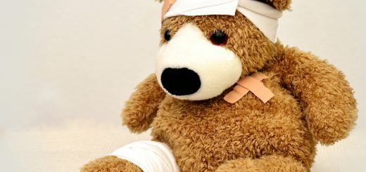 stuffed bear in bandages